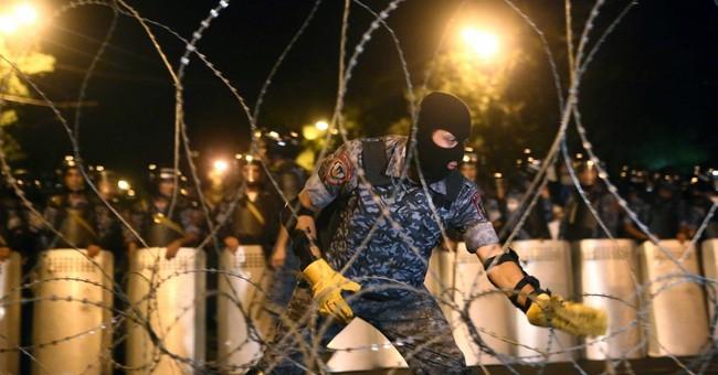 Armenia: 20 gunmen surrender, police station standoff over