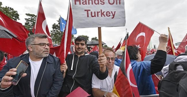 The Latest: 9 suspected of raiding Erdogan hotel captured