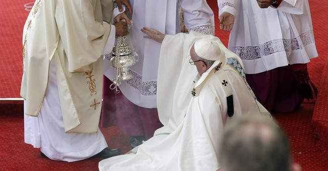 Pope: I fell because I forgot there was step at altar's edge