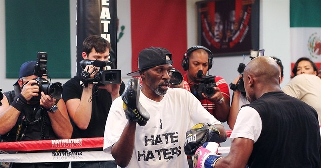 The Latest: Uncle, trainer of Floyd Mayweather Jr. found