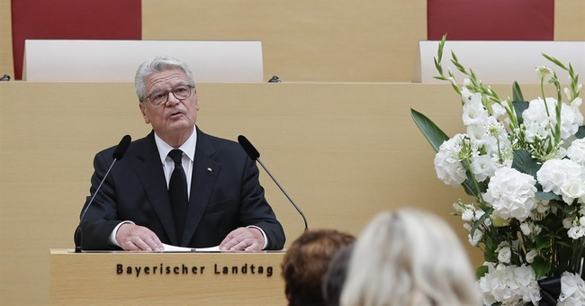 Germany mourns shooting victims, president vows resilience