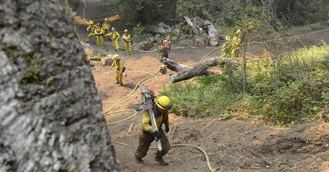 Central California homes threatened by 2 major wildfires