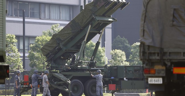Japan defense report raises China, North Korea concerns
