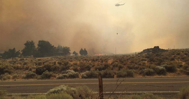 Wildfires burn in 7 Western states, prompt evacuations