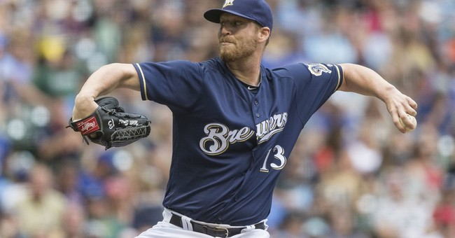 Giants get LHP Smith from Brewers for Susac, Bickford