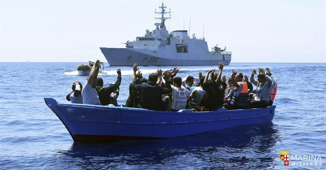 The Latest: Turkey's Erdogan blasts EU over migrant deal