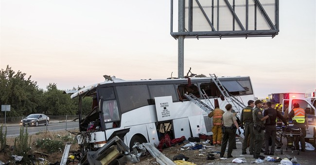 The Latest: Conditions upgraded for injured in bus crash