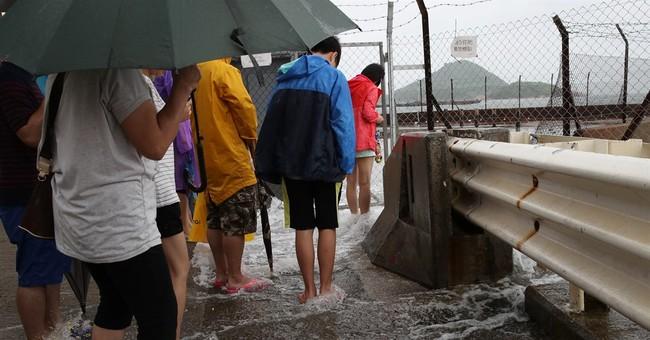 Typhoon Nida moving northwest across southern China