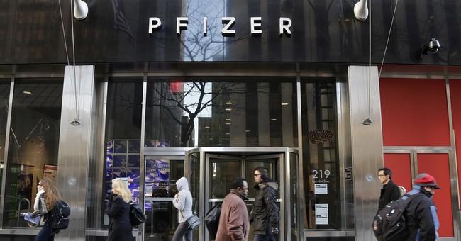 Pfizer beats Street 2Q forecasts despite big drop in profit