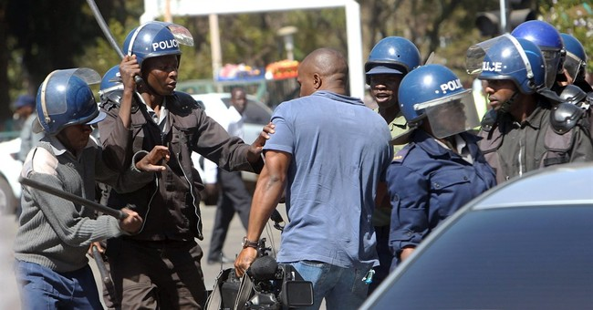 Zimbabwe police use tear gas to violently break up protests