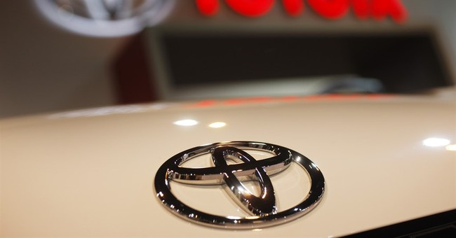 Toyota reports 14.5 pct drop in profit on yen, sales fall