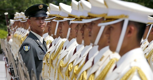 Image of Asia: A final check before honor guard is inspected
