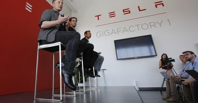 Tesla loss grows as it falls short of sales goals