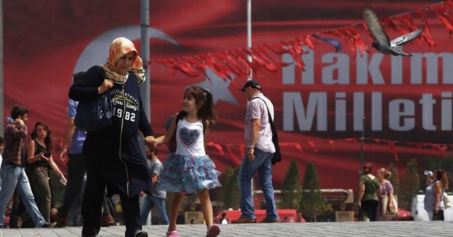 The Latest: EC chief opposes ending Turkey membership talks