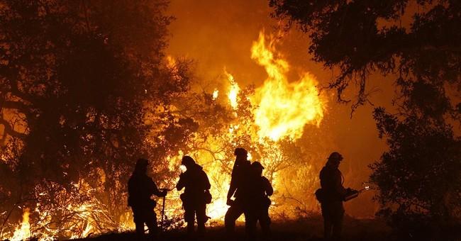 Big wildfires threaten communities across the Western US