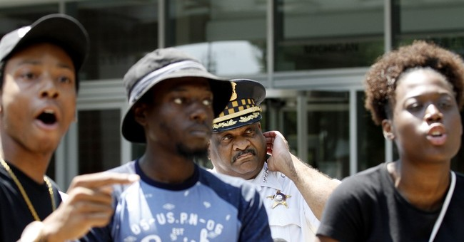 The Latest: Dozens rally after latest Chicago police videos