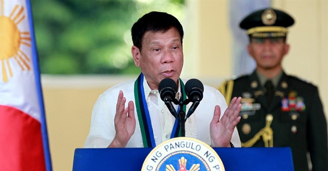 Philippine president acknowledges abuses in drug war