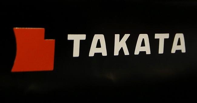 Takata still plans return to black for year as profit slips