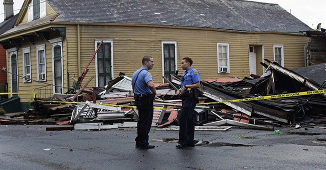 2 houses collapse as strong storms pummel New Orleans