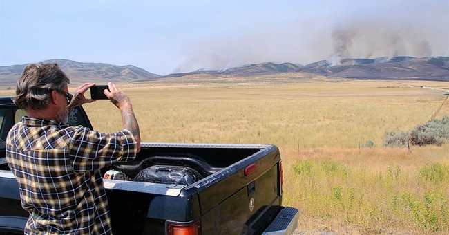 Utah wildfire torches 30 square miles, destroys structures