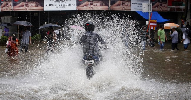Image of Asia: Driving through the rain in Mumbai