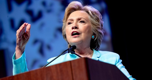 In historic role, Clinton brings a new look to leadership