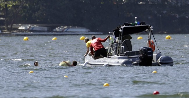 Weather woes for rowing as Serbs capsize in choppy water