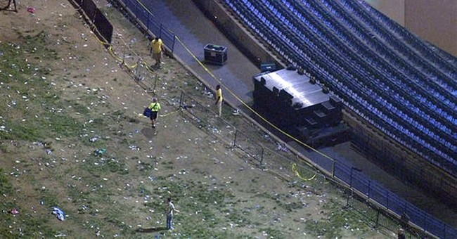 The Latest: Officials seek cause of concert railing collapse
