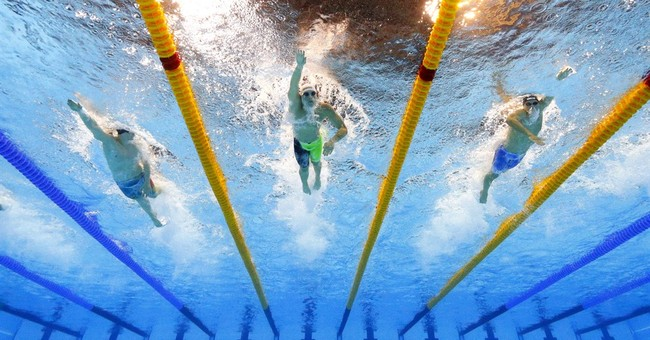Banned Russians quietly added back to Olympic swimming