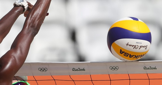 With flair, Olympic beach volleyball is underway
