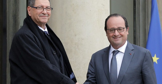 The Latest: France offers 1 billion euros to Tunisia