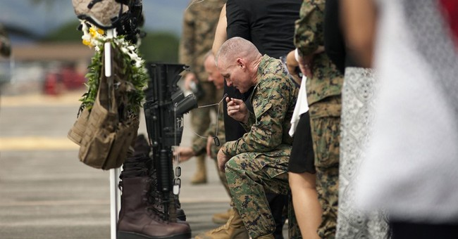 Flight gear adorns crosses for 12 Marines killed in Hawaii