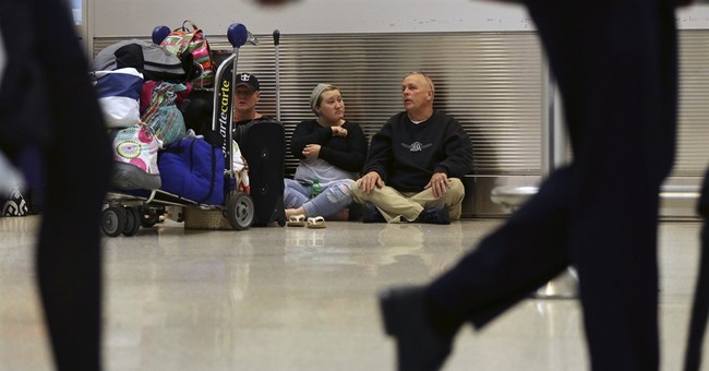 Airlines cancel flights as snowstorm snarls Eastern US