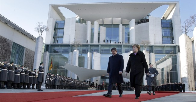 Merkel and Davutoglu seek solutions to migrant crisis