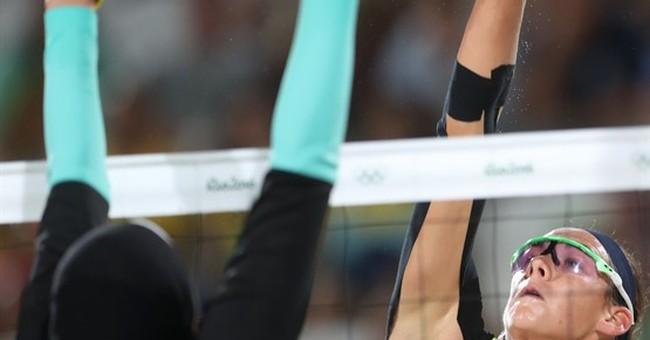 The Latest: US men take 4x100 freestyle gold, Phelps' 19th