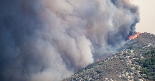 The Latest: Wind fans forest fire in Southern California