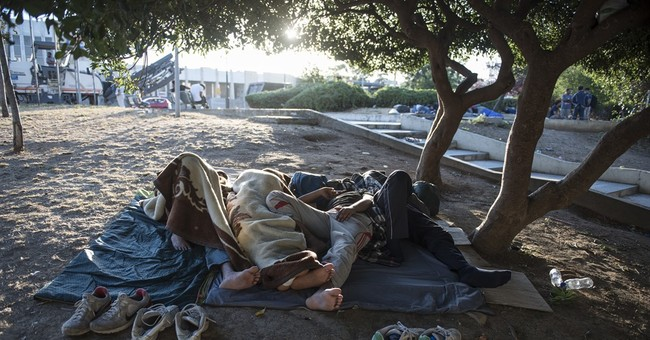 The Latest: Greece plans more apartments for migrants