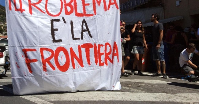 Pro-migrant group calls off Italy rally after weapons found