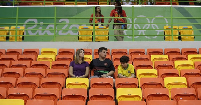 Olympic venues see thin crowds for some sports in Rio