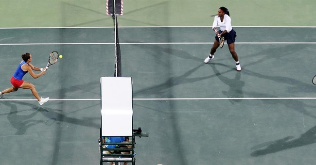 For 1st time, Williams sisters lose Olympic doubles match