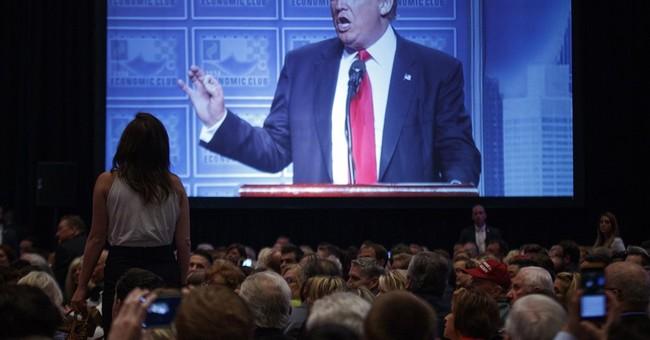 Trump tries to right his campaign, talking of tax cuts