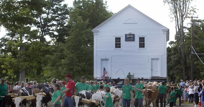 1823 schoolhouse moves back to its original spot atop hill