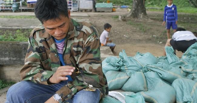 Laos' thirst for Mekong River dams imperils fishing, farming
