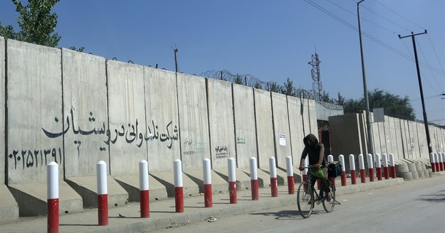 Afghan official: Gunmen abduct American, Australian in Kabul