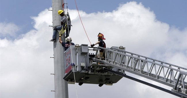 Worker atop 60-foot Texas football stadium lights rescued