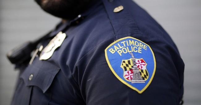 Report blasts Baltimore police over racial bias, force
