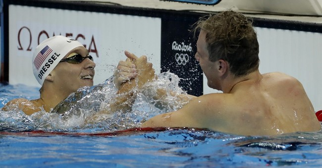 US women gymnasts, Phelps, Ledecky all golden again