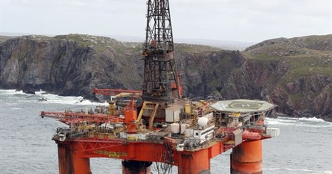 UK coast guards warn sightseers away from oil rig on beach