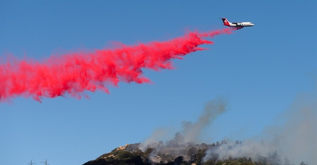 California wildfire surges, thousands of homes threatened