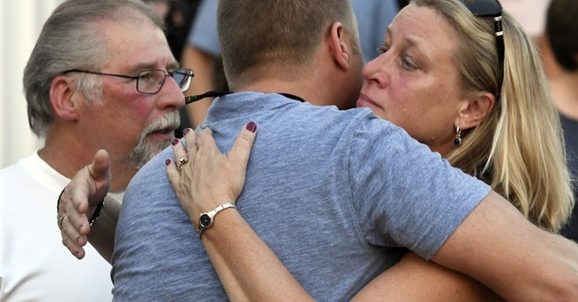 The Latest: Town holds vigil for slain woman found in woods